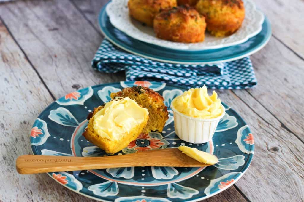 Gluten & Grain Free Garlic Cheddar Biscuits slathered with Butter - YUM!