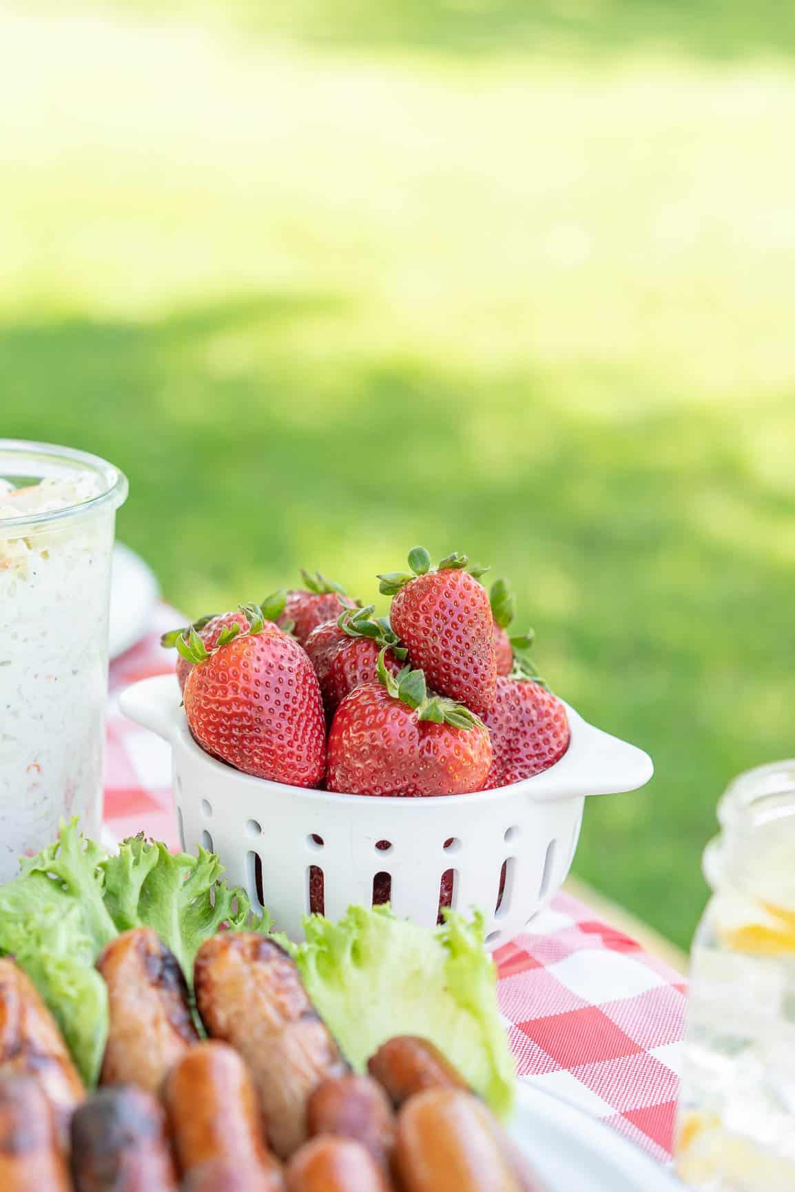 decorative colander of fresh strawberries.