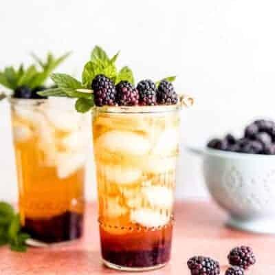 Refreshing Sparkling Peach Tea Blackberry Smash Mocktail