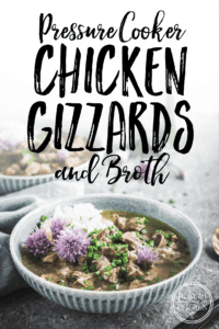 Pressure Cooker Chicken Gizzards and Broth served with Rice and Chive Blossoms