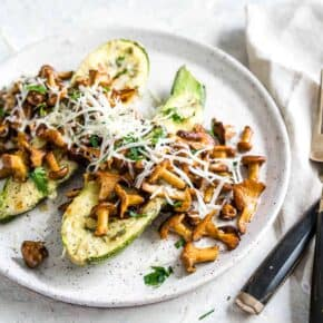 Keto Cheese Stuffed Zucchini Boats topped with Chanterelle Mushrooms