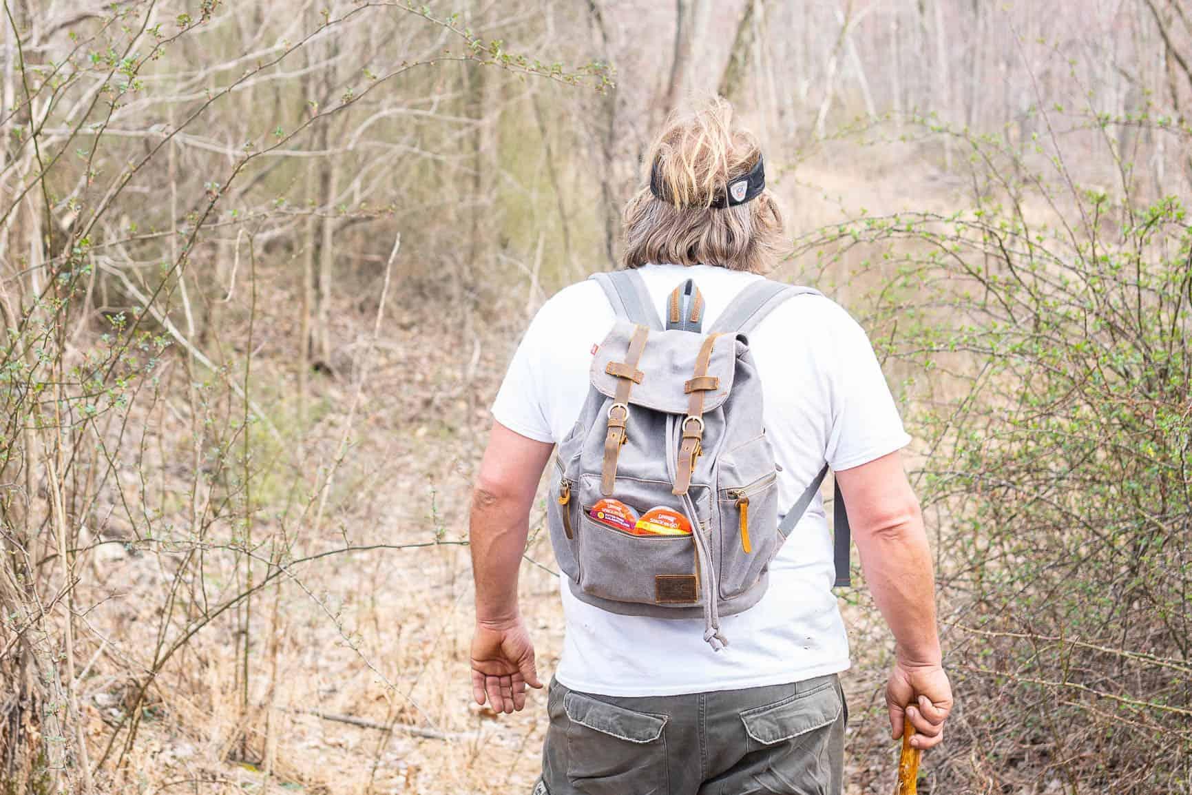 man with white t shirt hiking