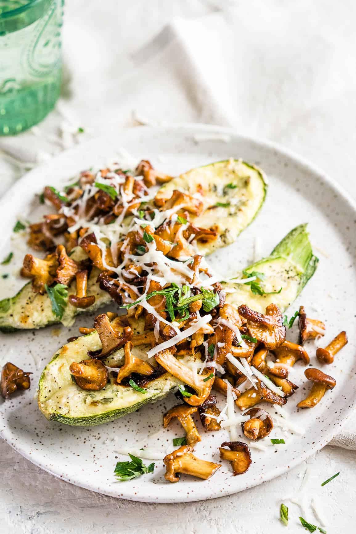 Keto Cheese Stuffed Zucchini Boats topped with Chanterelle Mushrooms