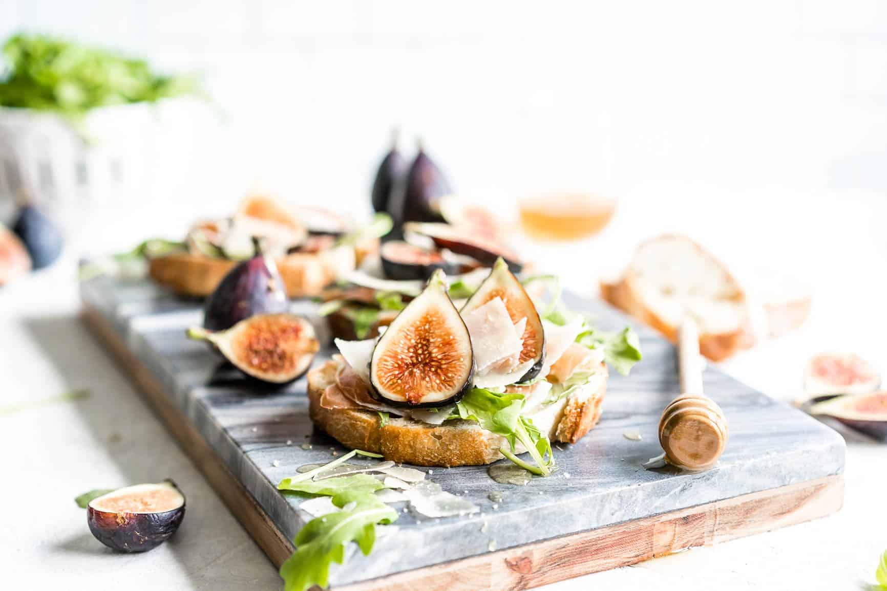 This flavorful Fig Bruschetta is an easy, yet delicious appetizer.It's also perfect for dinner parties, picnics, and any occasion where you want to serve something that is simple yet sophisticated.Toasted bread rubbed with garlic, topped with fresh figs, prosciutto, arugula and features Copper Kettle Cheese, drizzled with honey